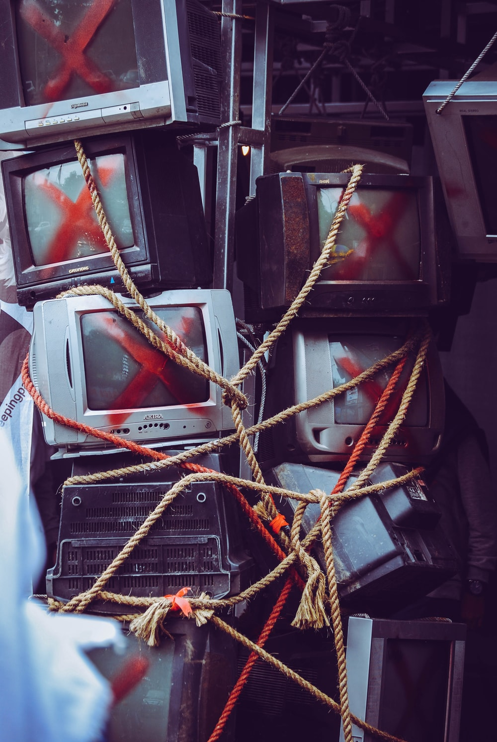 pile of assorted CRT TV's