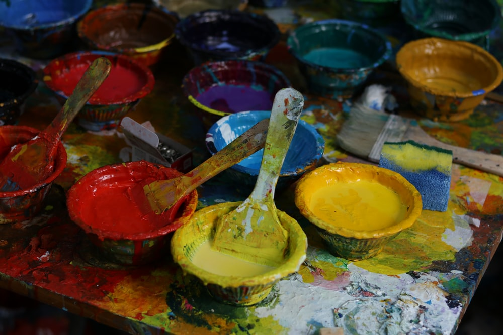 yellow, red, and blue paint containers