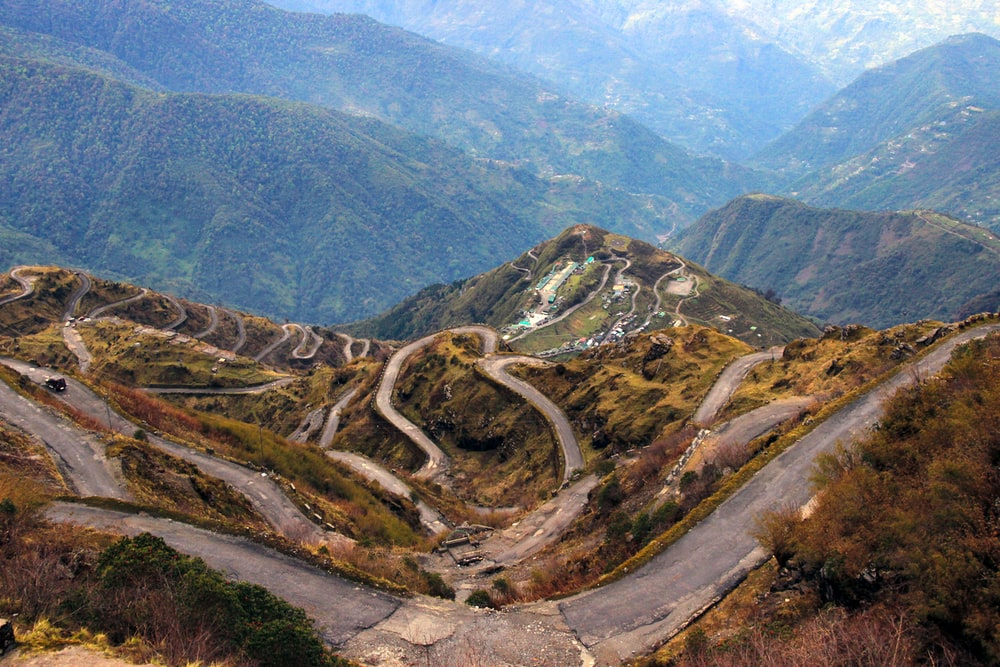 bird'-eye view photography of roads on hil