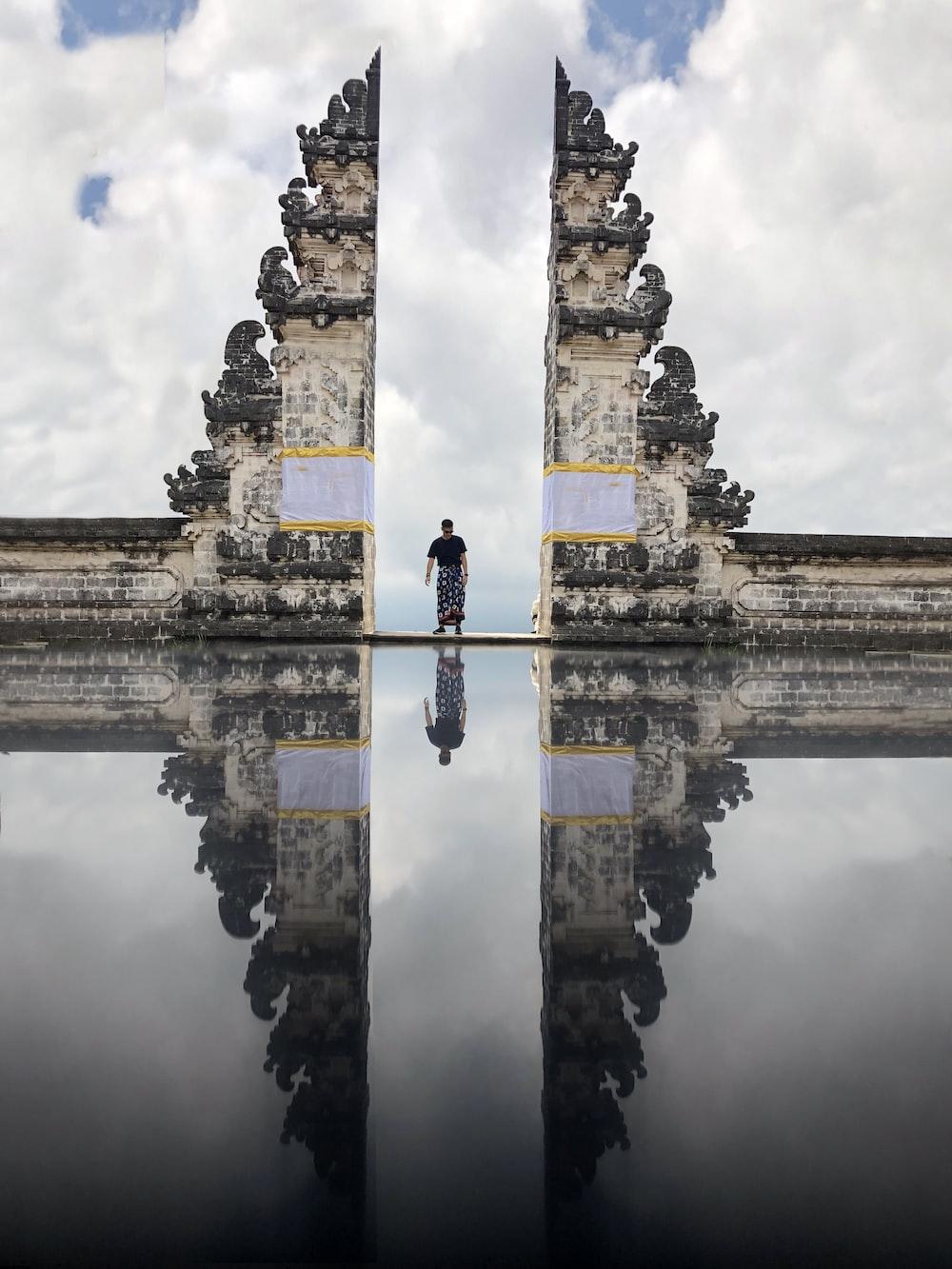 man standing between white hallway
