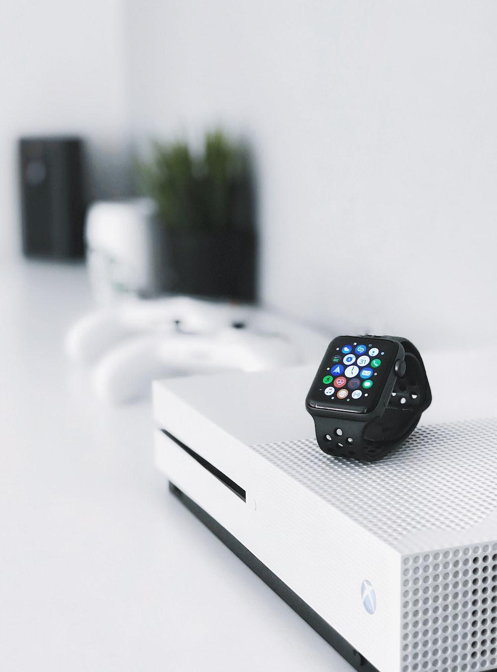 black aluminum case Apple Watch on white Xbox One console