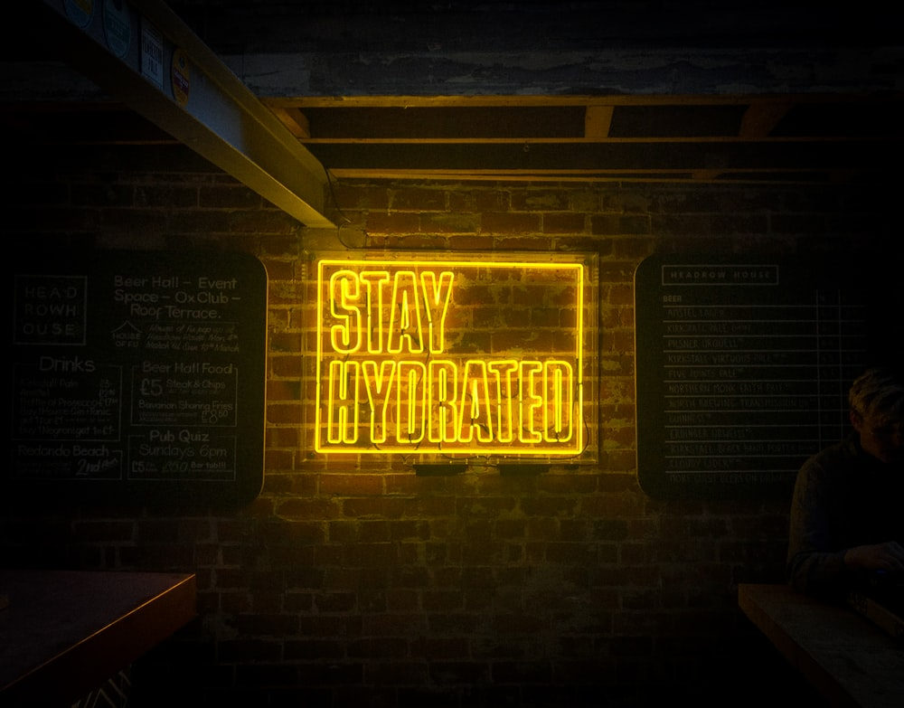 lighted yellow stay hydrated signage
