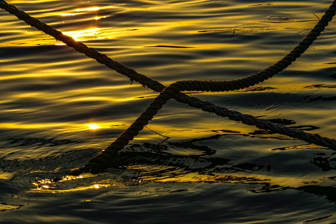Sunrise at the Bebek coast with boats' ropes gently caressing the morning waves.  August 2004, Istanbul.