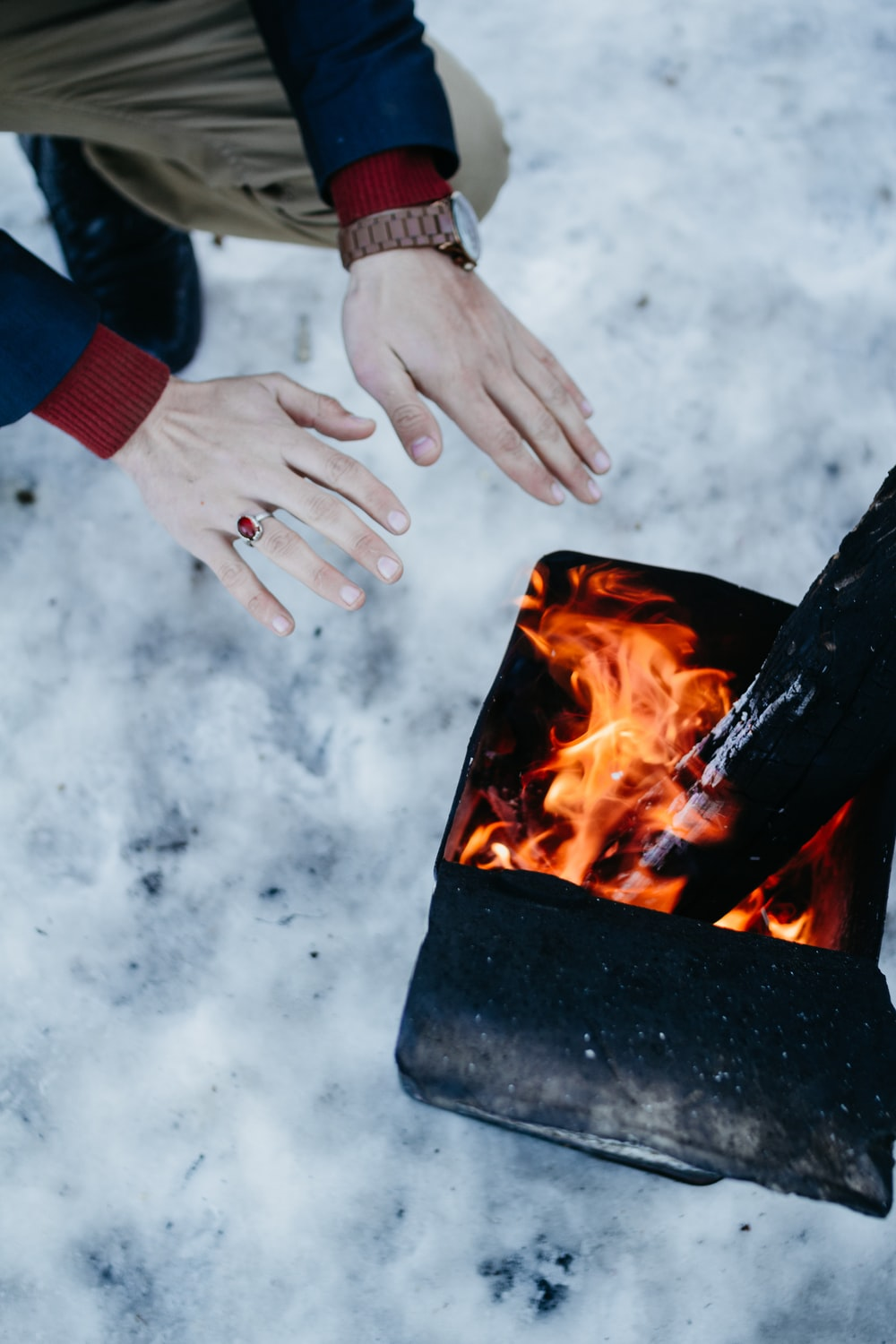 person warming hands on fire