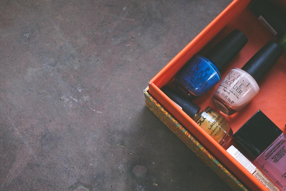 nail polish bottles inside red box