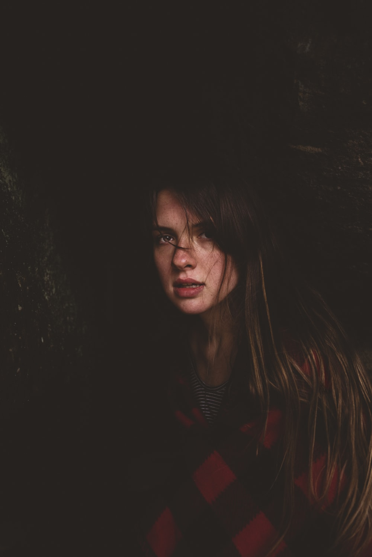 woman on dark place