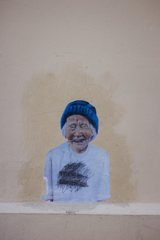 smiling woman wearing blue knit cap