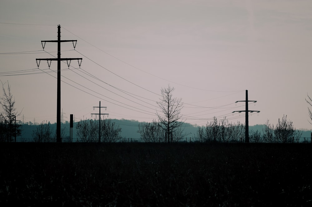 silhouette photo of transmission post