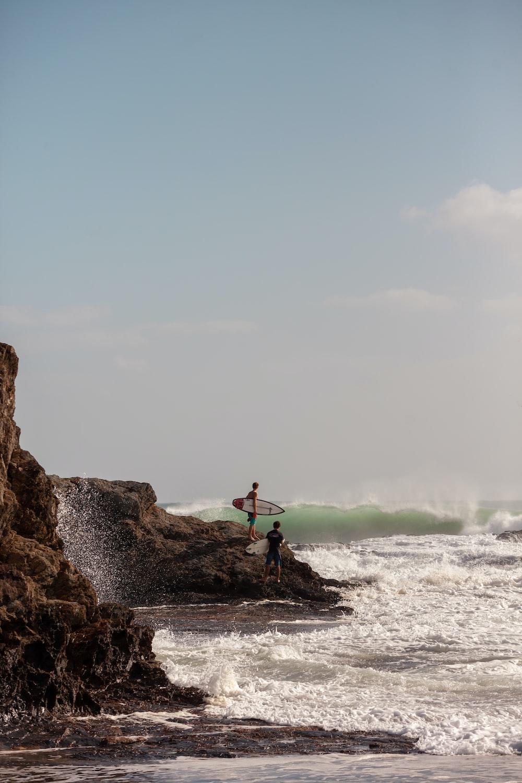 surfers on rock