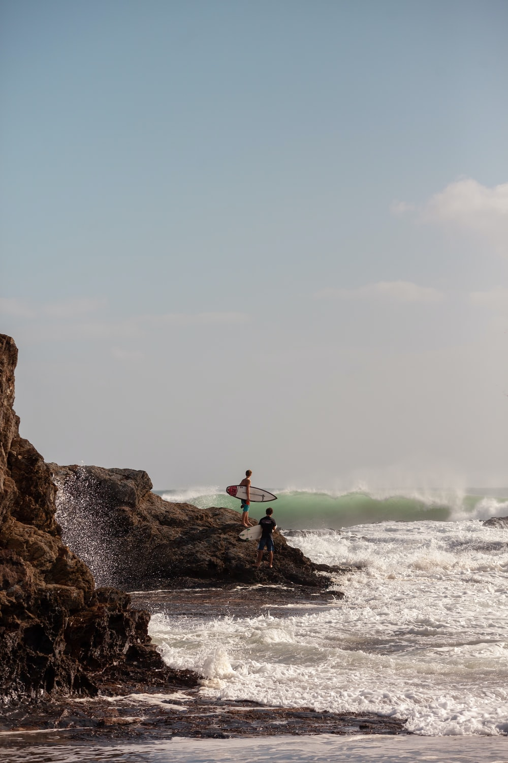 surfers on rock