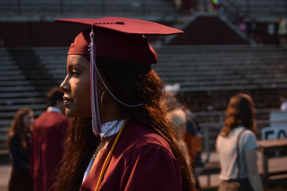 woman wearing red graduation cap