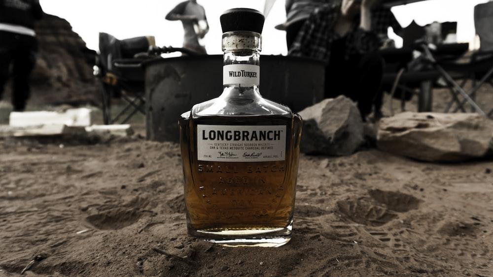 Longbranch bottle on sandy surface