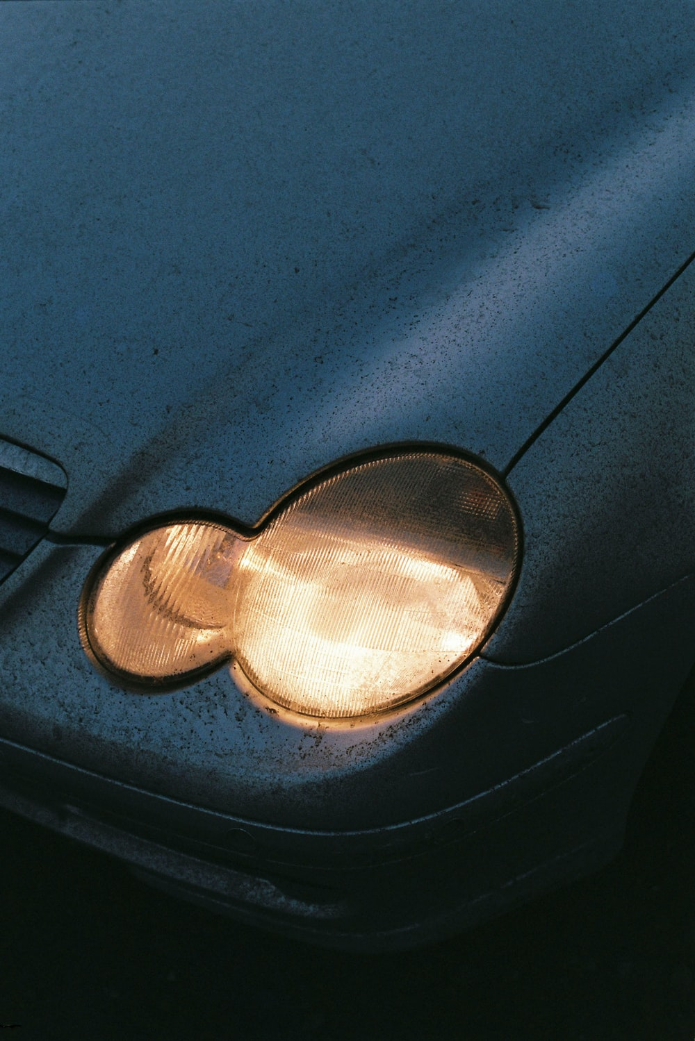 close-up photography of vehicle's headlight