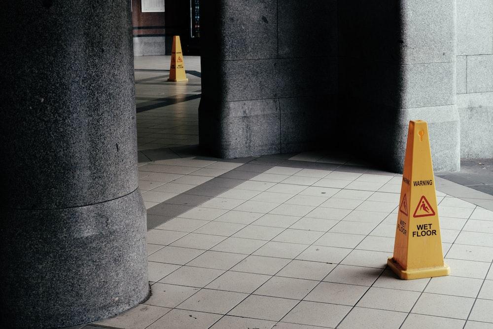 wet floor signage cone on tile floor