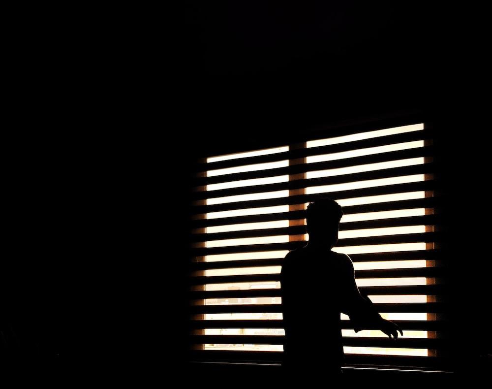 man standing near window