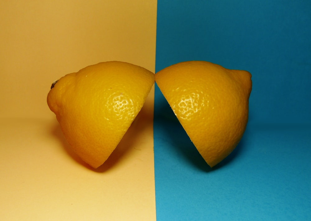 two sliced lemons on surface