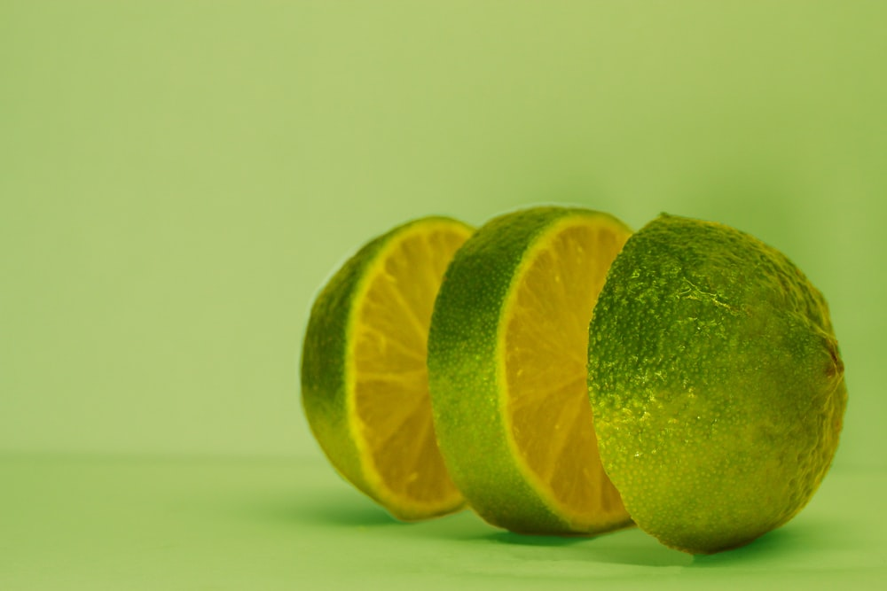 sliced lime on green surface