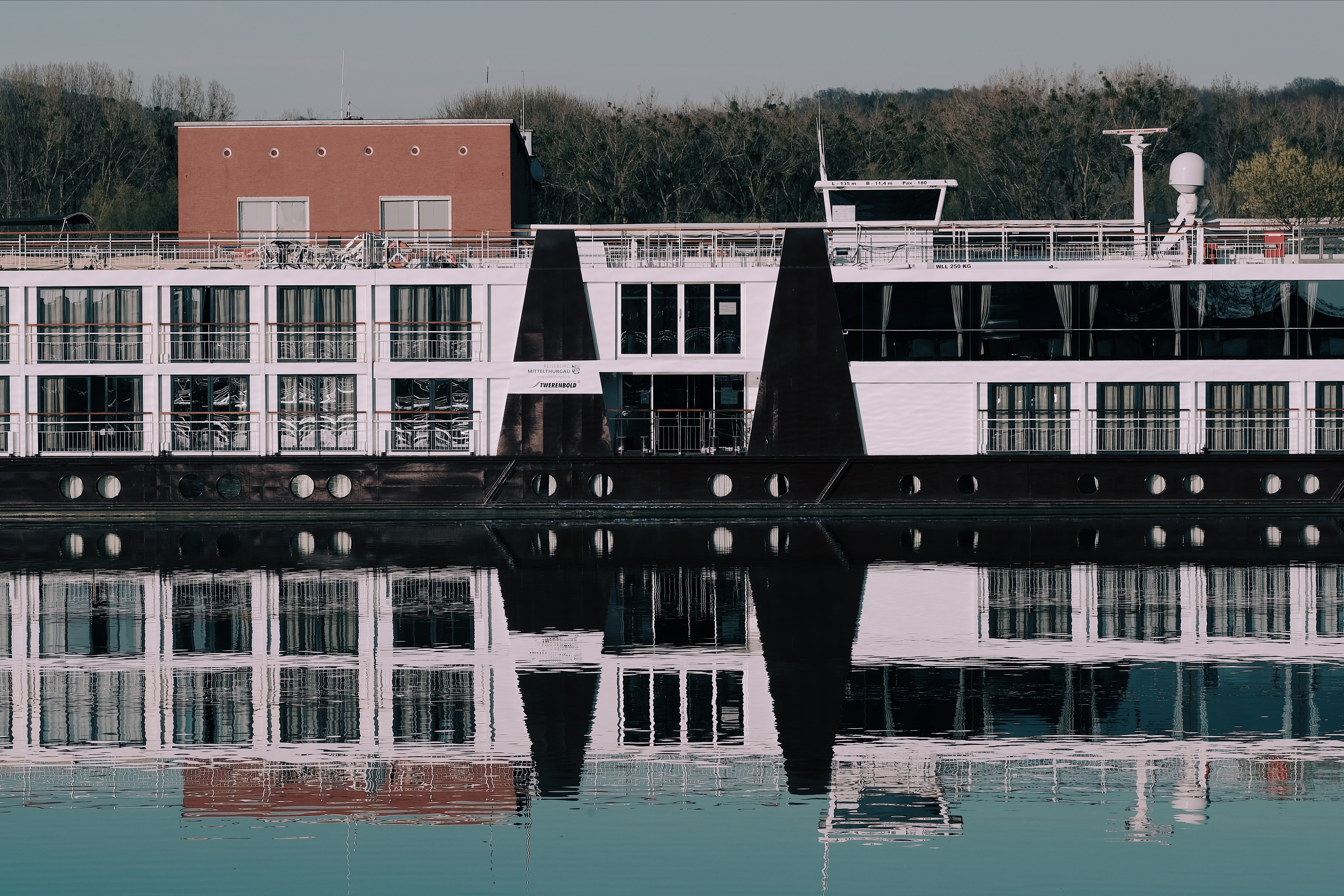 reflection photography of white building