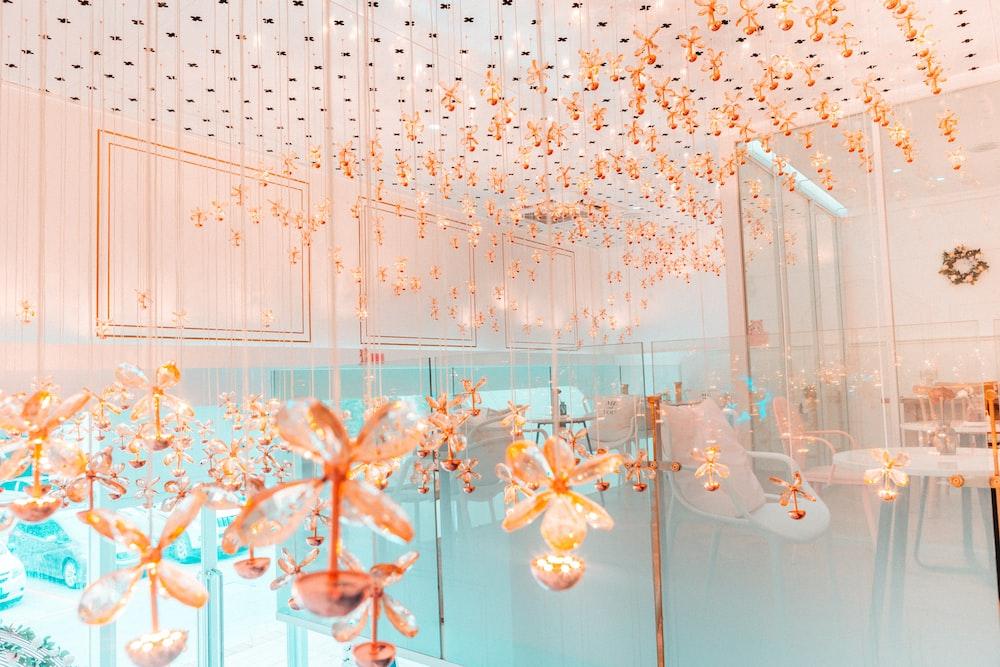 orange flower decors inside building showing table settings