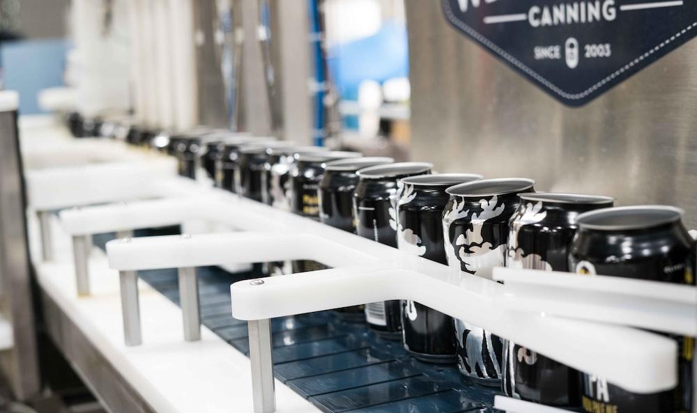 black labeled beverage cans