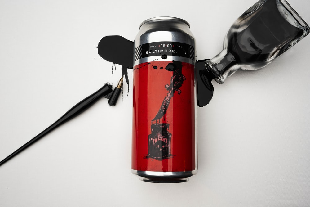 grey and red labeled can