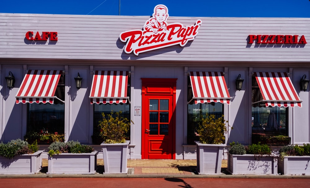 white and red Pizza Papi house with closed door