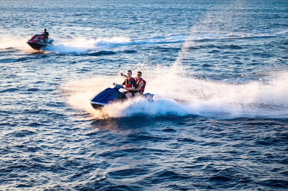 two men riding on jetski