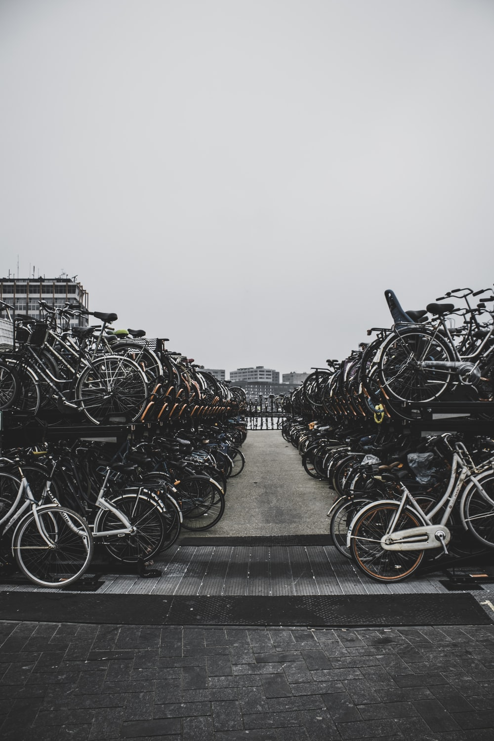 pile of bicycles outside during daytime