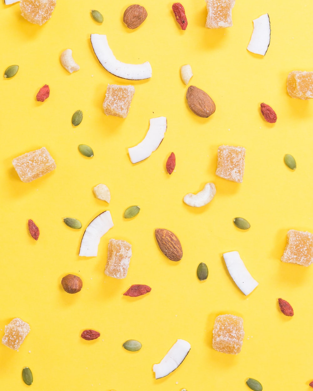nuts and beans on yellow surface
