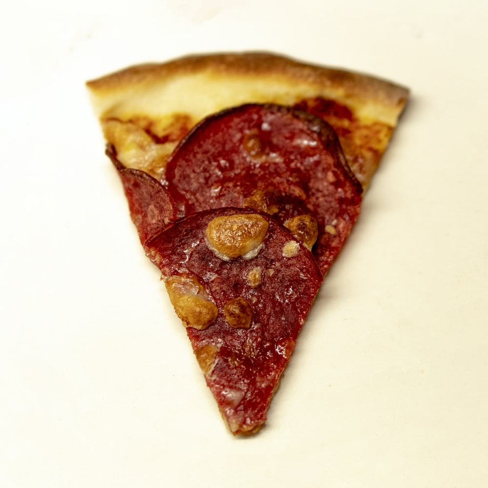 sliced pizza on white surface