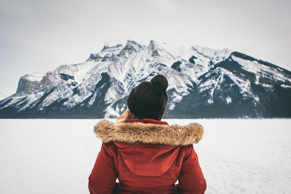 woman standing near mountain