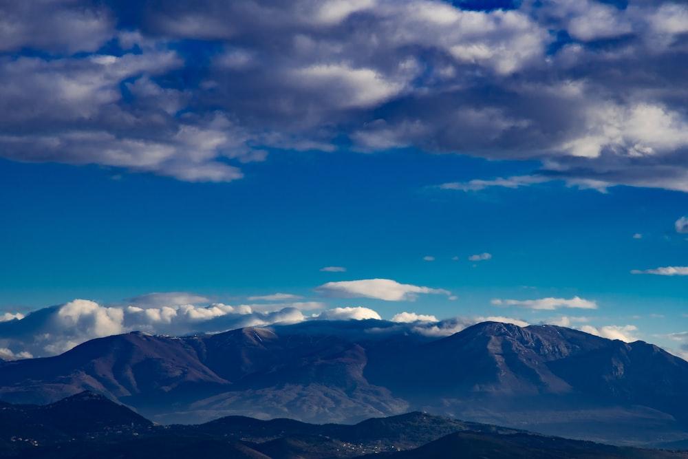 mountains under skies