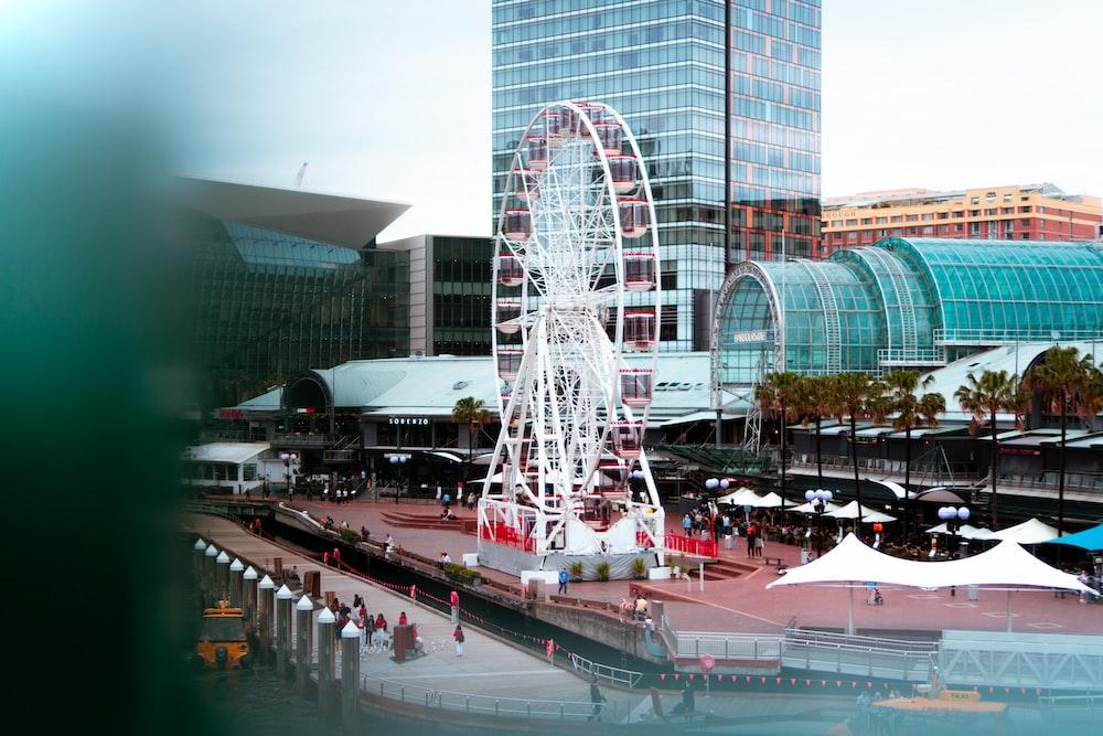 white Ferris wheel near building during daytime
