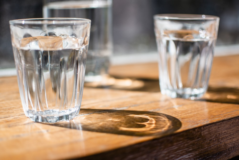 three clear drinking glass on table