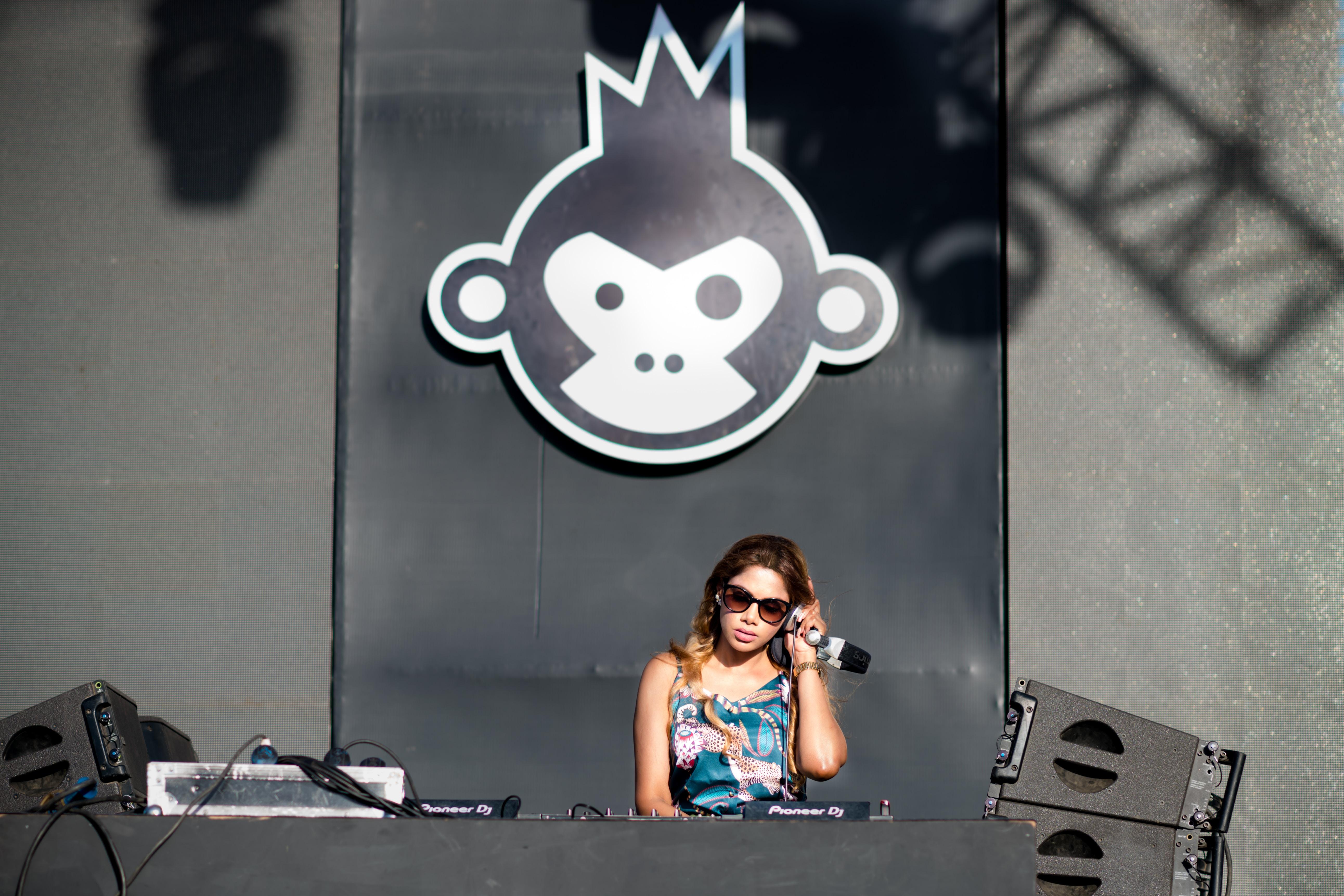 woman standing playing DJ controller during daytime