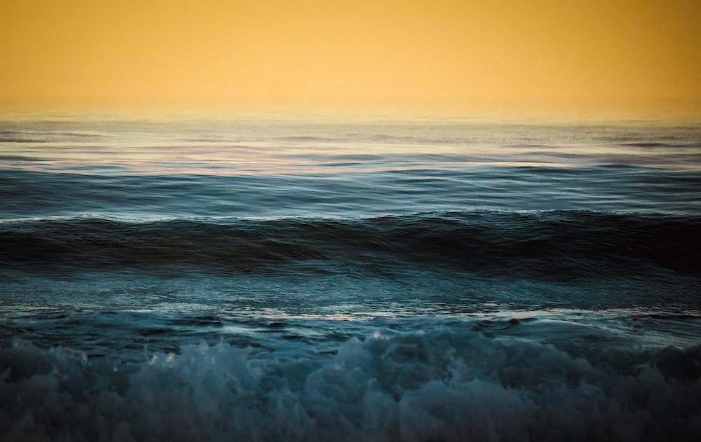 calm sea under clear sky