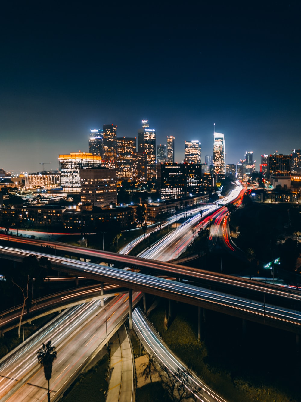 time lapse photo of cars passing by bridge during nighttime