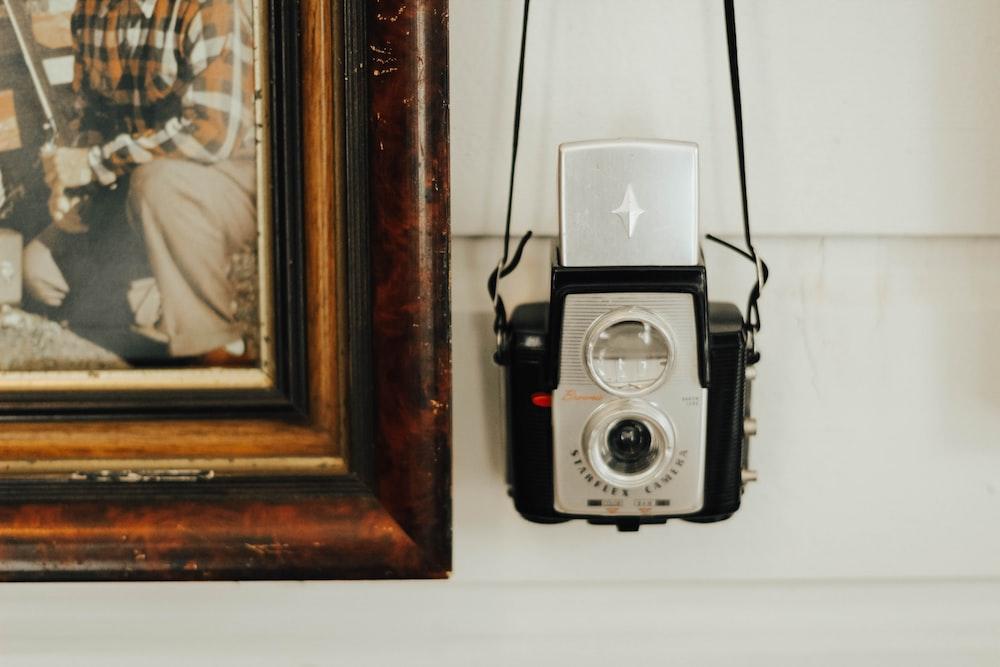 hanging camera near painting