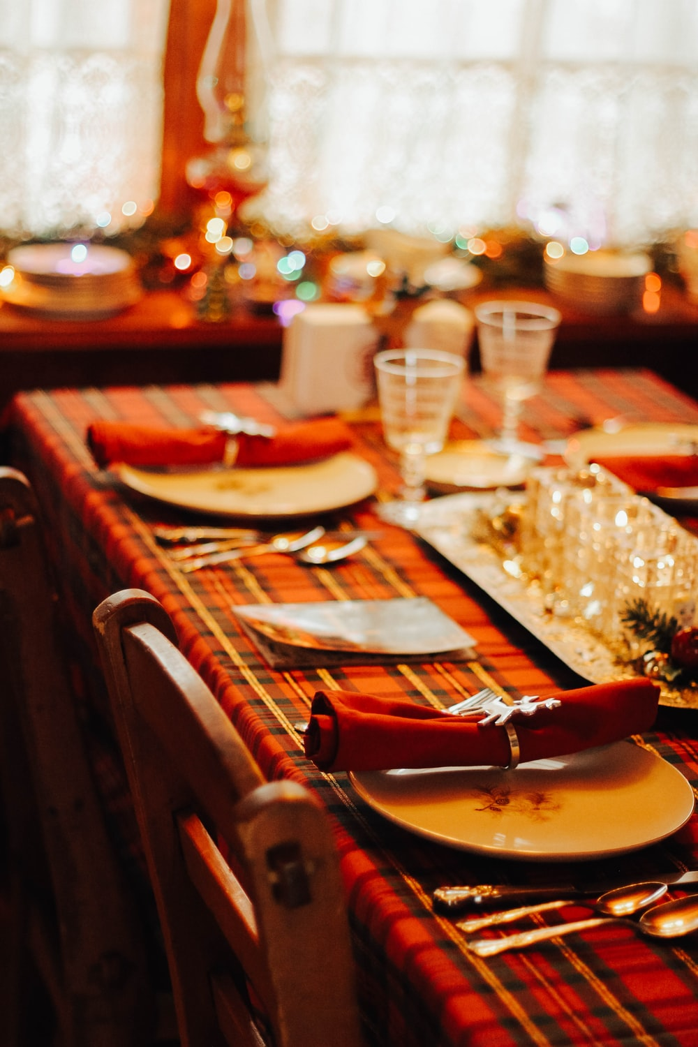 dining utensils set on table with red plaid linen