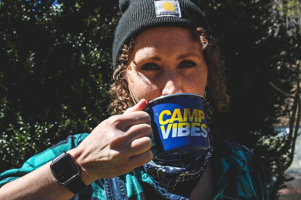 woman sipping coffee mug