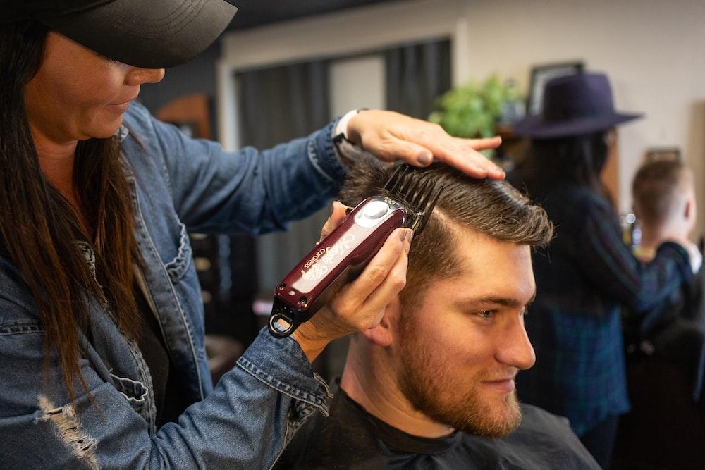 woman hair clipping man's hair