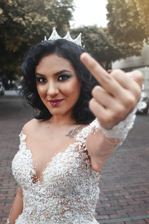 woman raising left middle finger