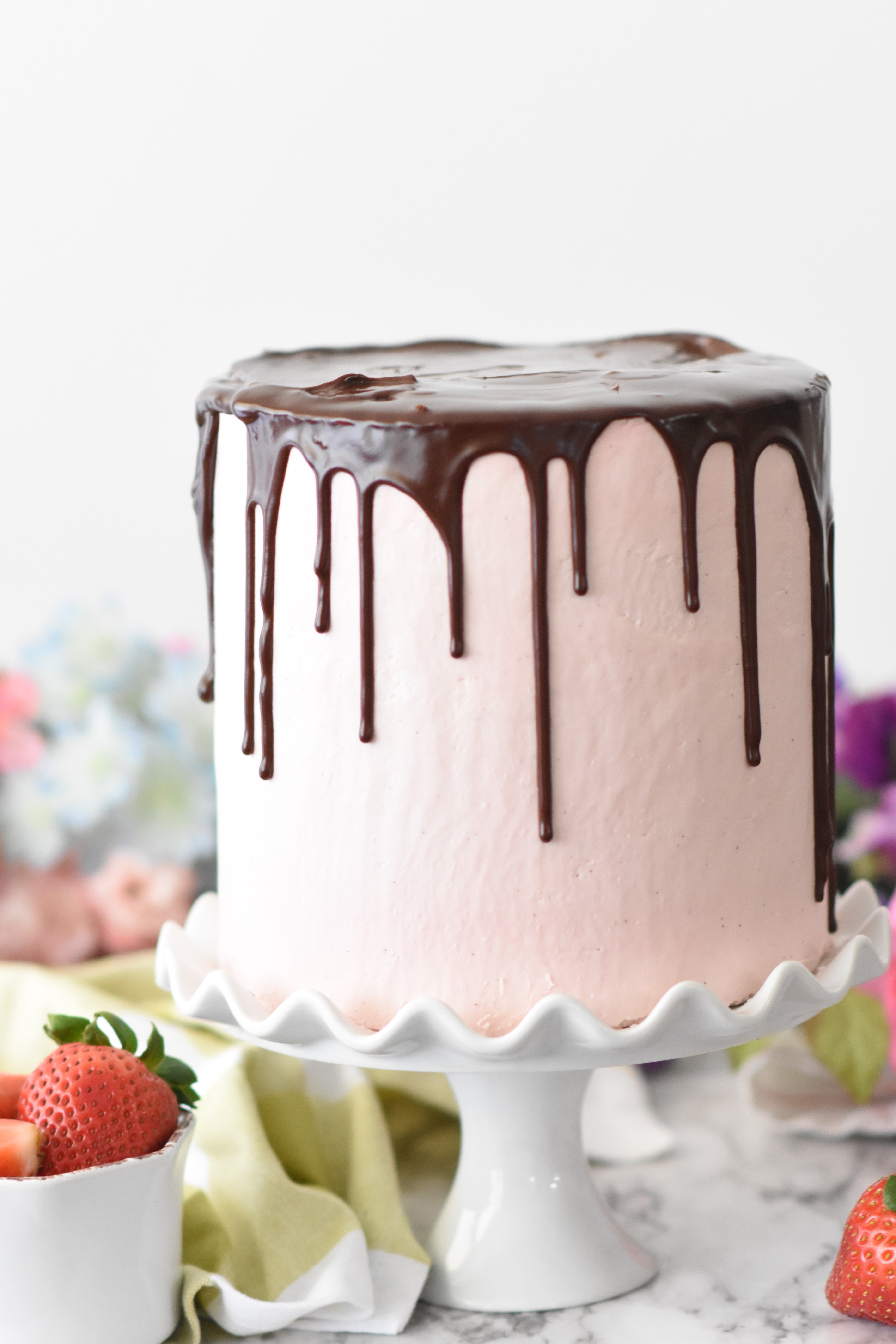 pink cake with chocolate on tray