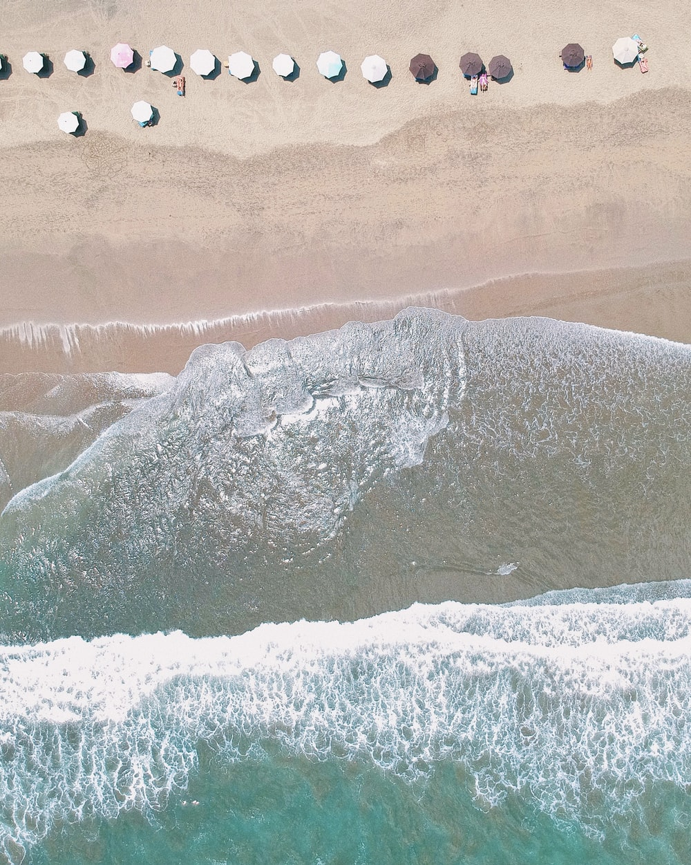aerial photography of parasol on seashore