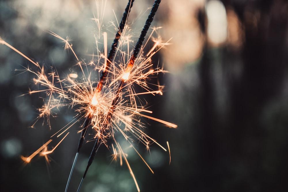 selective focus photo of sparkle stick