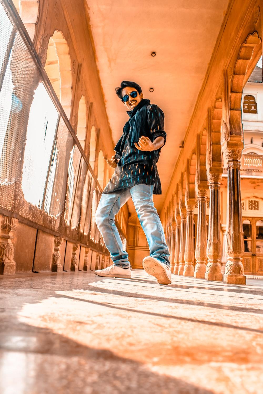 dancing man inside building interior