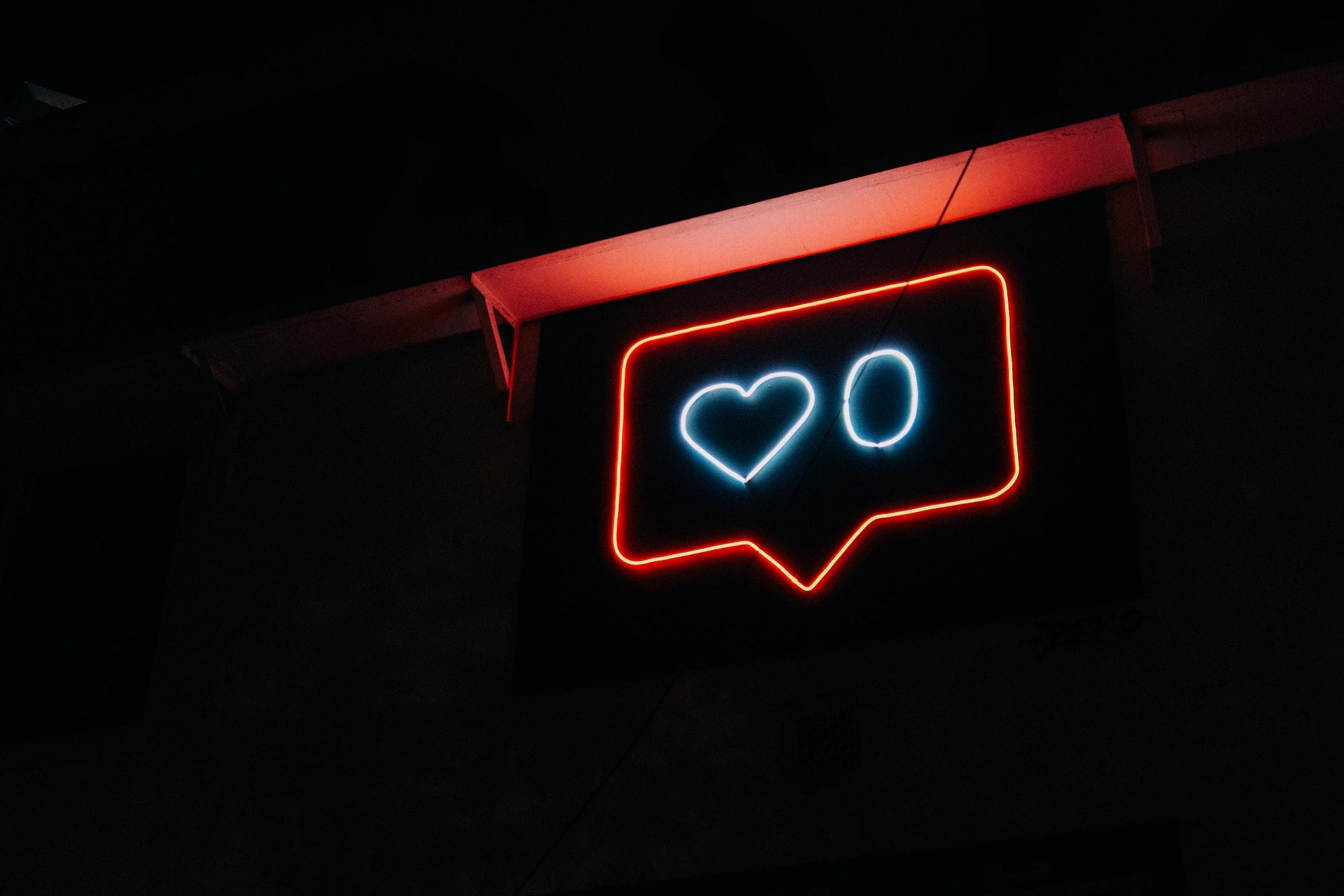 Neon instagram likes symbol.