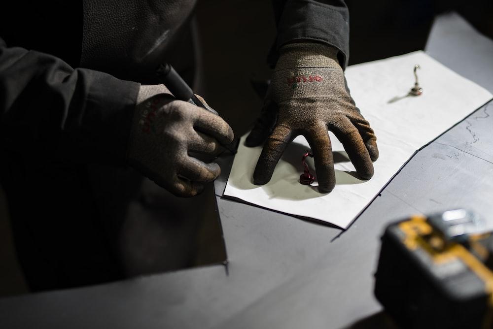 man marking on paper