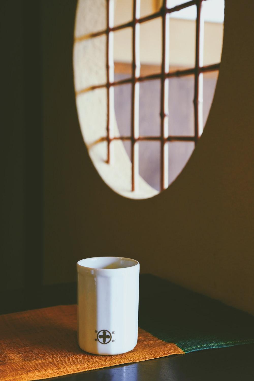 white mug on table