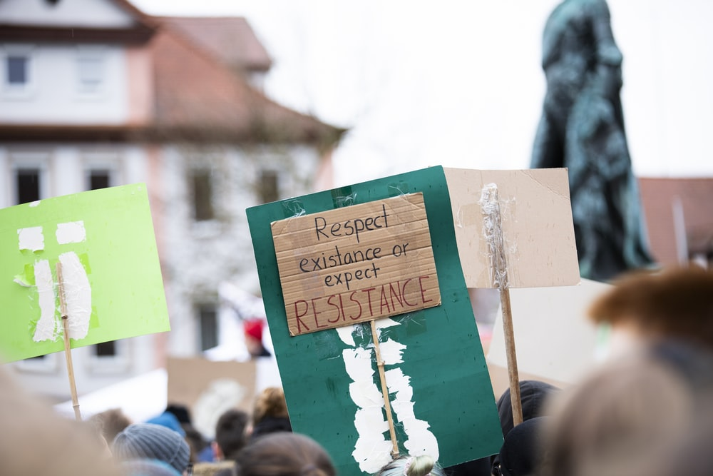respect existance or expect resistance signage during daytime